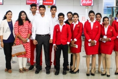 ZEFT Aviation Students, trainer and management with Air Asia Ground Staff team near Air Asia Check-in counter